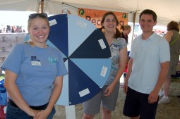 "Here I am (left), with Allison Voglesong (center), and Justin Sterk (right), showing off our ""Wheel of Water"" at Green Day"