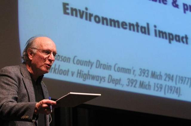 Jim Olson, chairman of For Love of Water, explains the possible legal approaches that might be taken to regulate hydraulic fracturing, or 'fracking,' Thursday evening at the Alverson Center for Performing Arts at Fowlerville High School. / ALAN WARD/DAILY PRESS & ARGUS