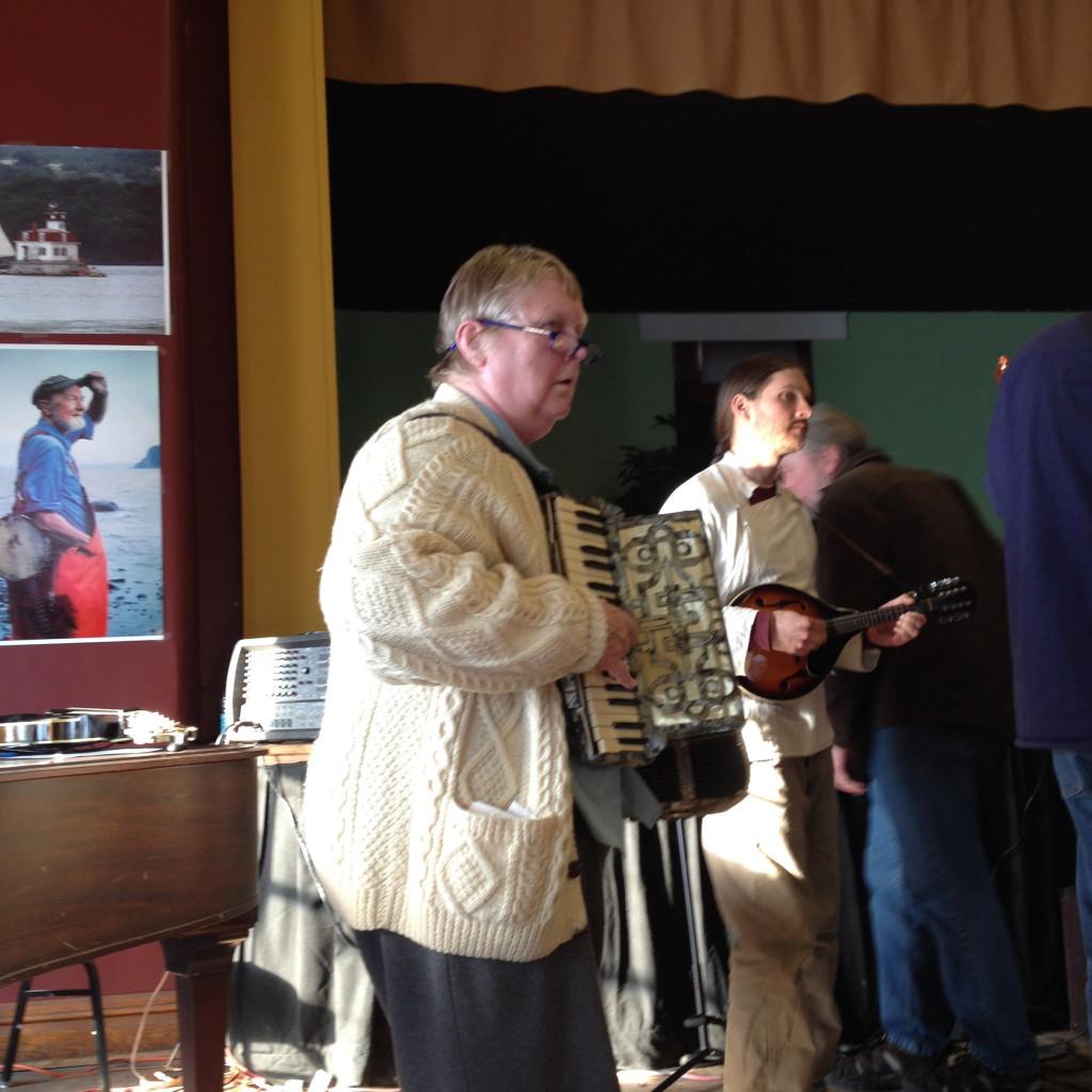 Carol on accordion and John on mandolin