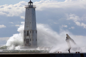 Frankfort Lighthouse with Surfer - John Russell